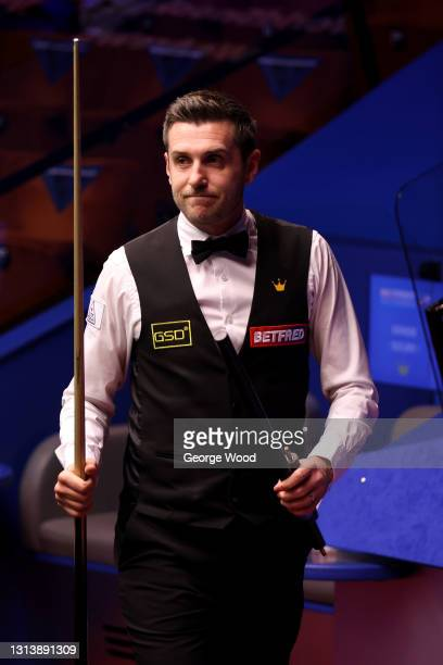 Mark Selby of England acknowledges the crowd after victory in the Betfred World Snooker Championship Round One match between Kurt Mafin of Norway and...