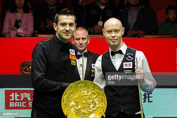 Mark Selby of England and Gary Wilson of England pose for a photo after Mark Selby winning the final match during day seven of the 2015 World Snooker...