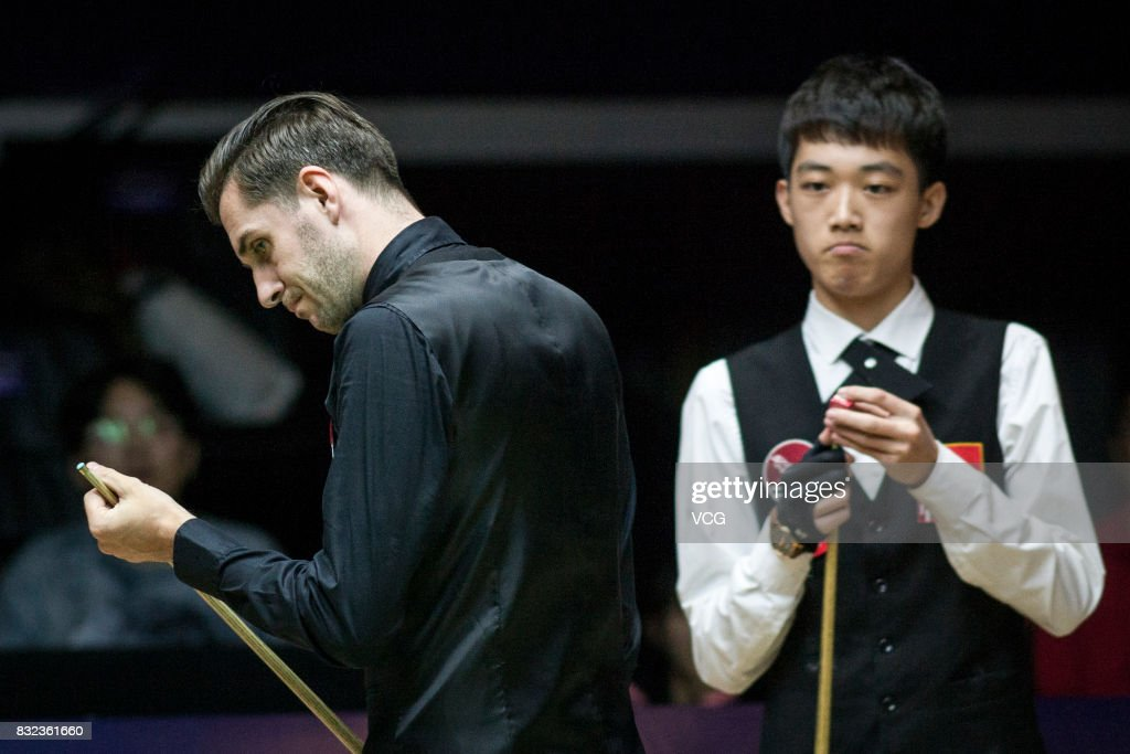 Mark Selby (L) of England and Luo Honghao of China look on during a qualifying match on day one of Evergrande 2017 World Snooker China Champion at Guangzhou Sport University on August 16, 2017 in Guangzhou, Guangdong Province of China.