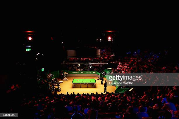 Mark Selby of England breaks off against John Higgins of Scotland during the Final of the 888.com World Championship at the Crucible Theatre on May...