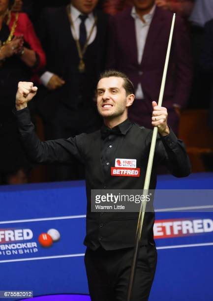 Mark Selby of England celebrates after beating John Higgins of Scotland in the final of the World Snooker Championship on day seventeen at Crucible...