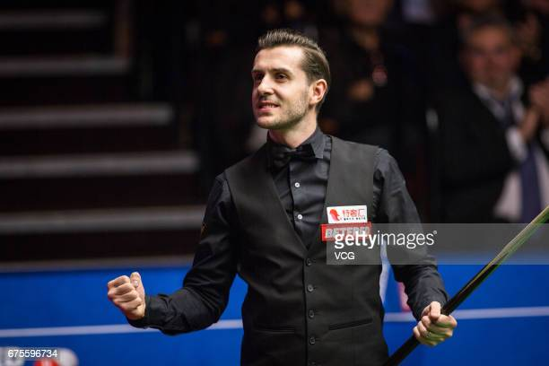Mark Selby of England celebrates after winning the final match against John Higgins of Scotland on day seventeen of Betfred World Championship 2017...