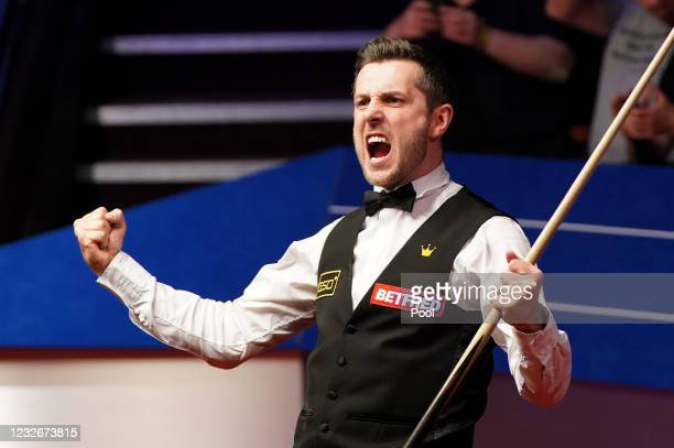 Mark Selby of England celebrates victory during the Final between Shaun Murphy and Mark Selby on day seventeen of the Betfred World Snooker...