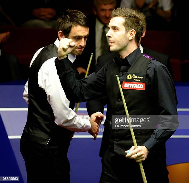 Mark Selby of England celebrates victory in his Quarter Final match against Ronnie O'Sullivan of England during the Betfredcom World Snooker...