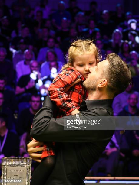 Mark Selby of England celebrates with his families after winning the final match against David Gilbert of England on day seven of 2019 English Open...