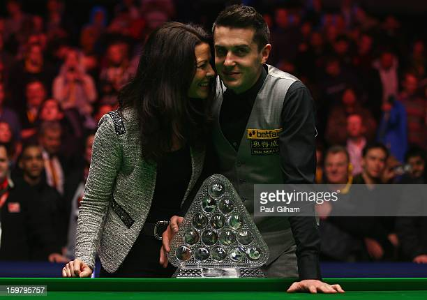 Mark Selby of England celebrates with his wife Vikki Layton and The Masters Trophy after winning The Masters Final between Mark Selby of England and...