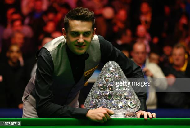 Mark Selby of England celebrates with The Masters Trophy after winning The Masters Final between Mark Selby of England and Neil Robertson of...