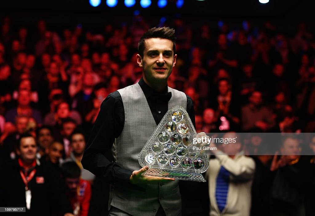 Mark Selby of England celebrates with The Masters Trophy after winning The Masters Final between Mark Selby of England and Neil Robertson of Australia at Alexandra Palace on January 20, 2013 in London, England.