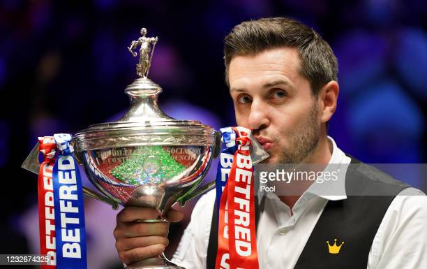 Mark Selby of England celebrates with the trophy following his victory during the Final between Shaun Murphy and Mark Selby on day seventeen of the...