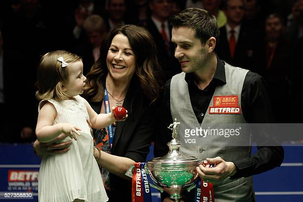 Mark Selby of England celebrates with wife Nikki and daughter Sophia after beating Ding Junhui of China to win the World Snooker Championship final...