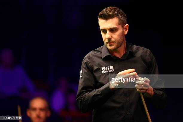 Mark Selby of England chalks the cue during the 1st round match against David Grace of England on day one of the 2020 ManBetX Welsh Open at the...