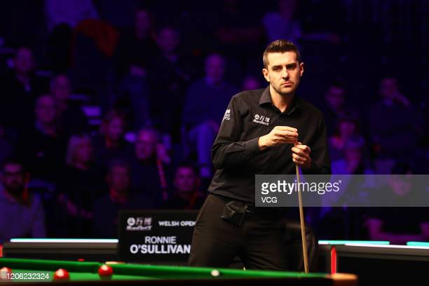 Mark Selby of England chalks the cue during the quarterfinal match against Ronnie O'Sullivan of England on day five of the 2020 ManBetX Welsh Open at...