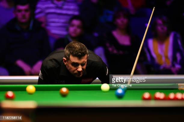 Mark Selby of England eyes the ball in the final match against David Gilbert of England on day seven of 2019 English Open at K2 Leisure Centre on...