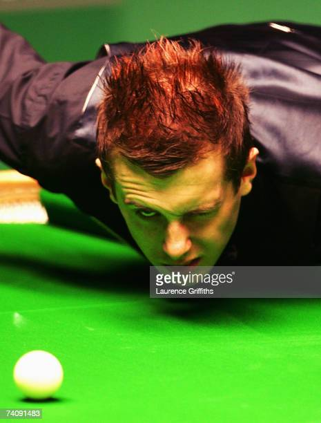 Mark Selby of England eyes up a shot in his match against John Higgins of Scotland during the Final of the 888com World Championship at the Crucible...