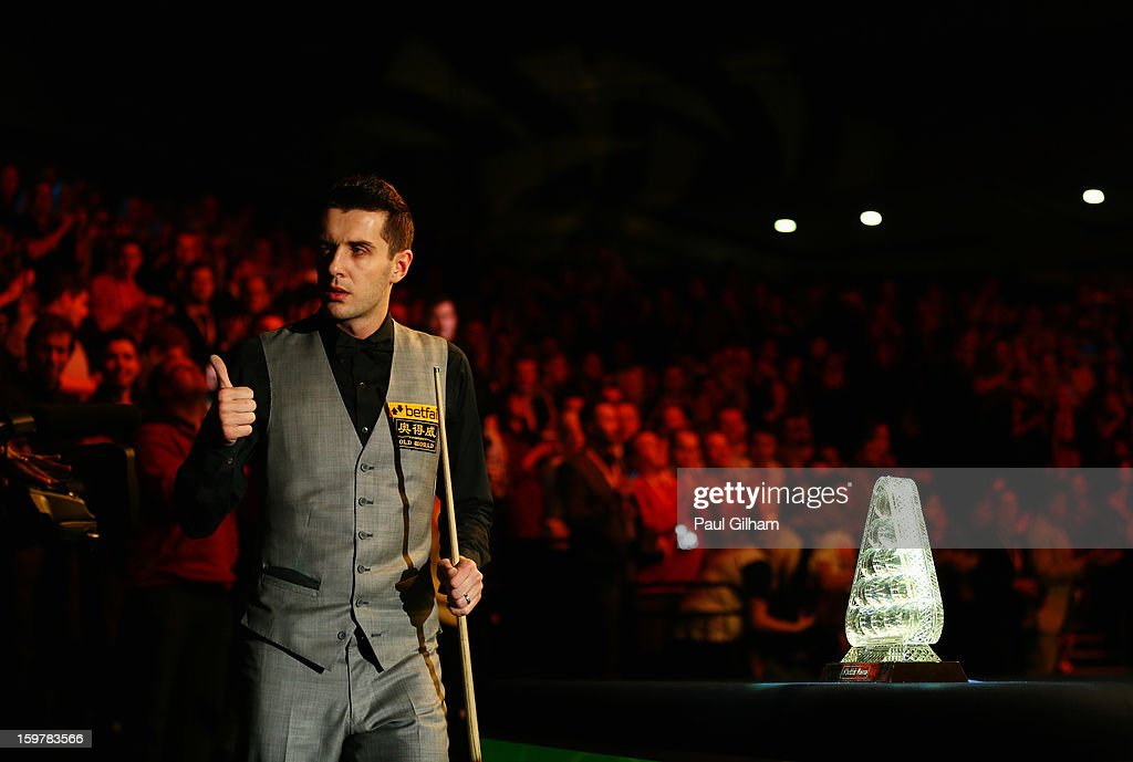 Mark Selby of England gives the thumbs up to the camera as he walks past The Masters Trophy during The Masters Final between Mark Selby of England and Neil Robertson of Australia at Alexandra Palace on January 20, 2013 in London, England.