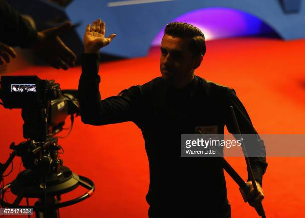 Mark Selby of England is conagratulated by the fans during his final match against John Higgins of Scotland on day seventeen of the World Snooker...
