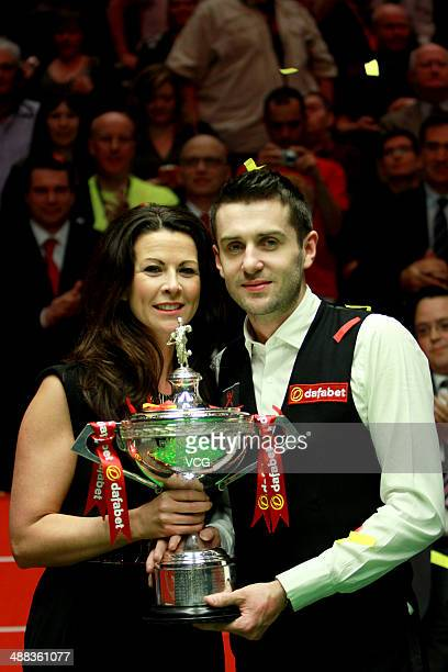 Mark Selby of England lifts the trophy with wife Vikki after winning The Dafabet World Snooker Championship final at Crucible Theatre on May 5 2014...