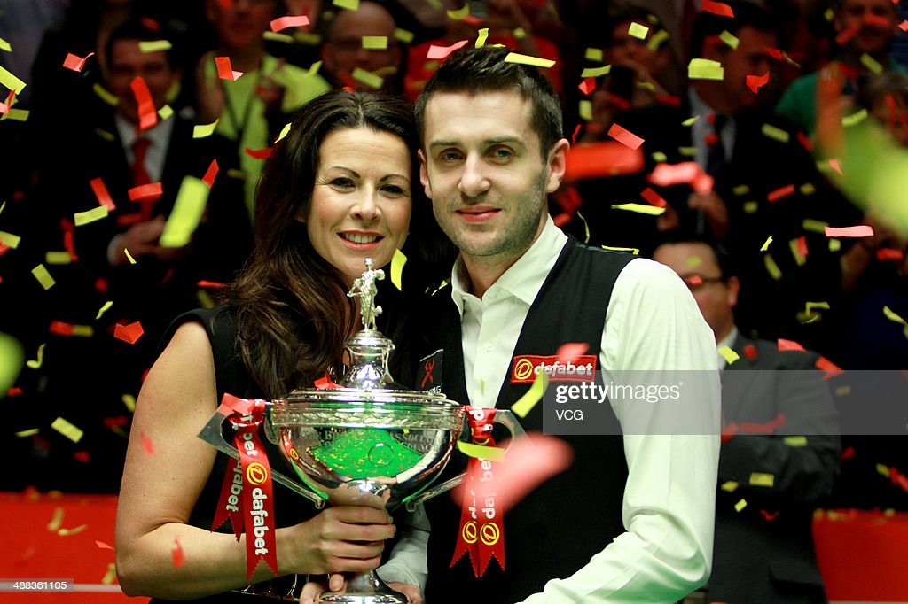 Mark Selby of England lifts the trophy with wife Vikki after ...