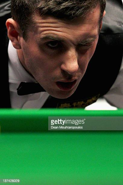 Mark Selby of England lines up his next shot during his Quarter Final match with Shaun Murphy of England during day six of The Masters at Alexandra...