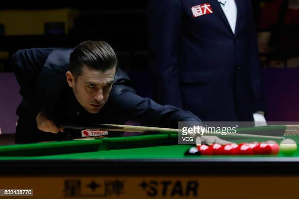 Mark Selby of England plays a shot during his first round match against Noppon Saengkham of Thailand on day two of Evergrande 2017 World Snooker...