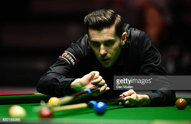 Mark Selby of England plays a shot during his quarter final match against Barry Hawkins of England on day six of the Dafabet Masters at Alexandra...