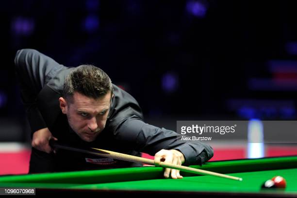 Mark Selby of England plays a shot during his quarter-final match against Judd Trump of England on day six of the 2019 Dafabet Masters at Alexandra...