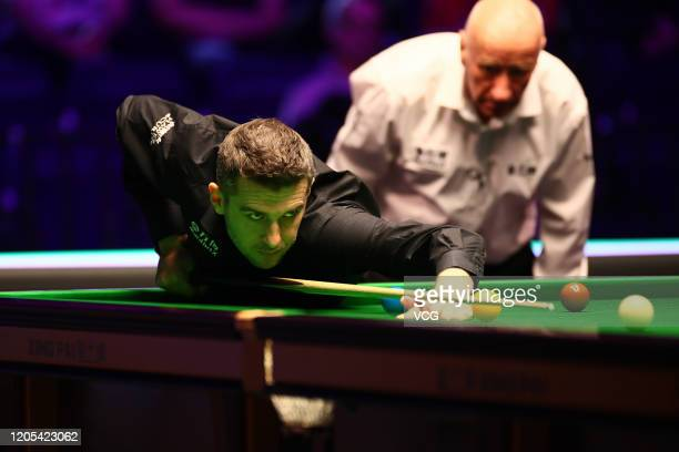 Mark Selby of England plays a shot during the 1st round match against David Grace of England on day one of the 2020 ManBetX Welsh Open at the...