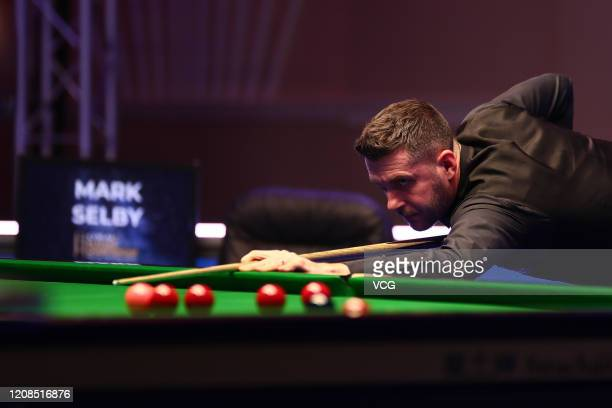 Mark Selby of England plays a shot during the 1st round match against Mark Williams of Wales on day one of the 2020 Coral Players Championship at the...