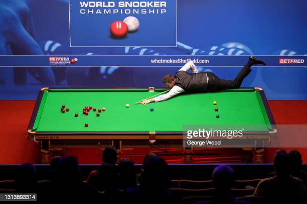 Mark Selby of England plays a shot during the Betfred World Snooker Championship Round One match between Kurt Mafin of Norway and Mark Selby of...