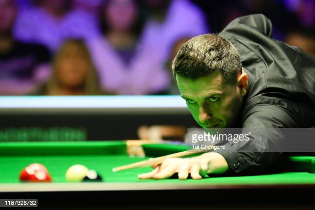 Mark Selby of England plays a shot during the quarterfinal match against John Higgins of Scotland on day five of 2019 Northern Ireland Open at...