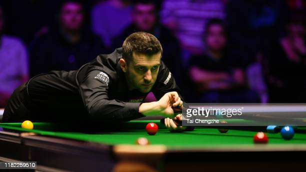 Mark Selby of England plays a shot in the final match against David Gilbert of England on day seven of 2019 English Open at K2 Leisure Centre on...