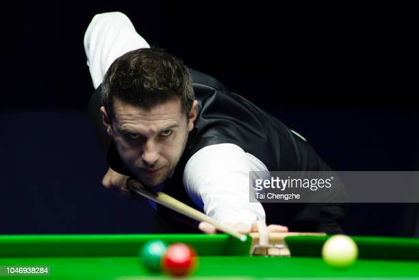 Mark Selby of England plays a shot in the final match against John Higgins of Scotland during day seven of the Evergrande 2018 World Snooker China...