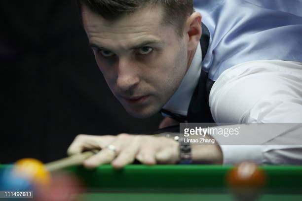 Mark Selby of England plays a shot in the final match against Judd Trump of England during day six of the Snooker China Open 2011 at Beijing...