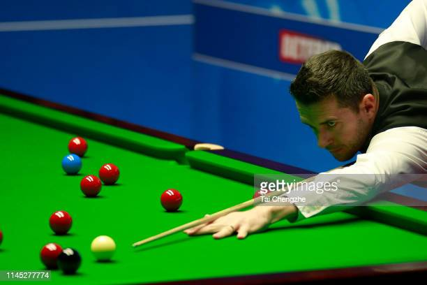 Mark Selby of England plays a shot in the second round match against Gary Wilson of England during day seven of the 2019 Betfred World Snooker...