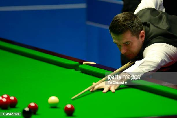 Mark Selby of England plays a shot in the second round match against Gary Wilson of England during day eight of the 2019 Betfred World Snooker...