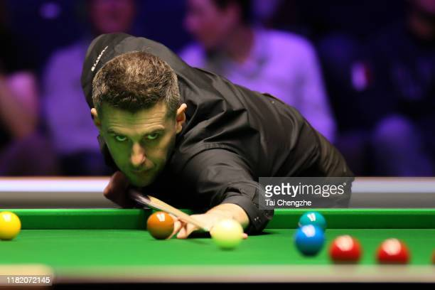 Mark Selby of England plays a shot in the semifinal match against Mark Allen of Northern Ireland on day six of 2019 English Open at K2 Leisure Centre...