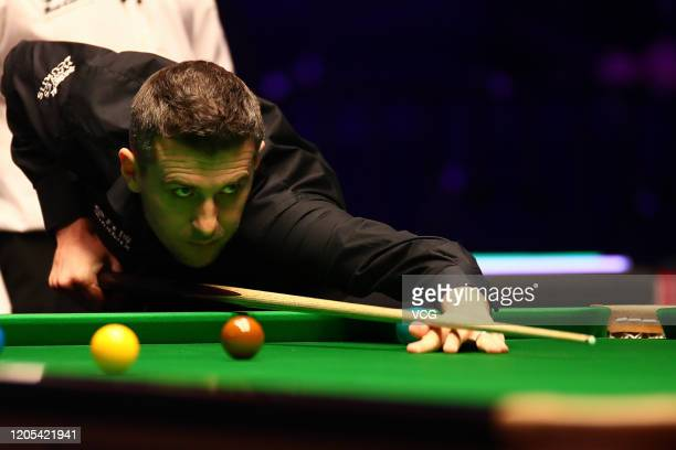 Mark Selby of England plays a shots during the 1st round match against David Grace of England on day one of the 2020 ManBetX Welsh Open at the...
