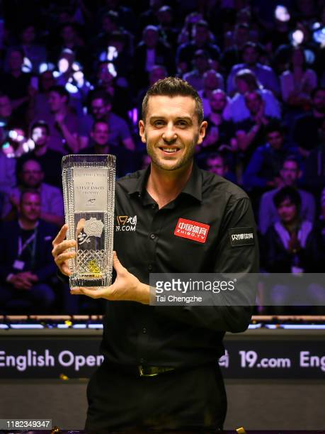Mark Selby of England poses with his trophy after winning the final match against David Gilbert of England on day seven of 2019 English Open at K2...