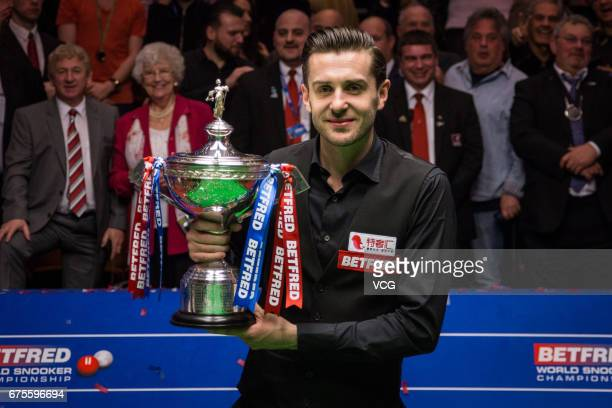Mark Selby of England poses with his trophy after winning the final match against John Higgins of Scotland on day seventeen of Betfred World...