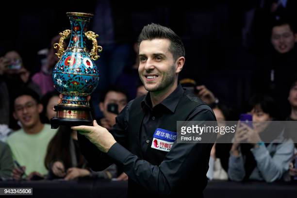 Mark Selby of England poses with the trophy after beating Barry Hawkins of England in the final of the 2018 China Open on day seventeen on April 8...