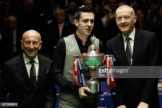 Mark Selby of England poses with the trophy after beating Ding Junhui of China to win the World Snooker Championship final on day seventeen of...