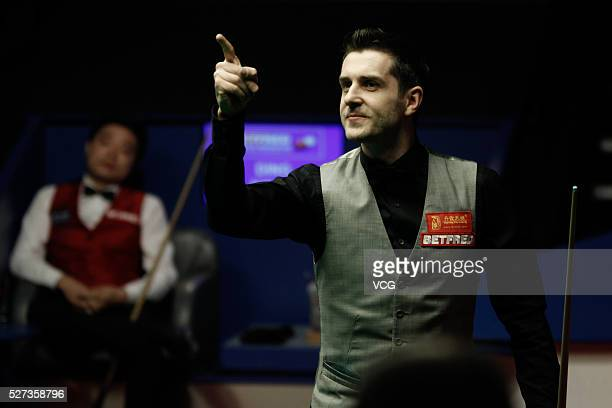 Mark Selby of England reacts after beating Ding Junhui of China to win the World Snooker Championship final on day seventeen of Betfred World...