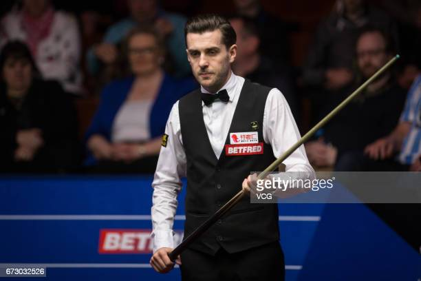 Mark Selby of England reacts during his quarter final match against Marco Fu of Chinese Hong Kong on day eleven of Betfred World Championship 2017 at...