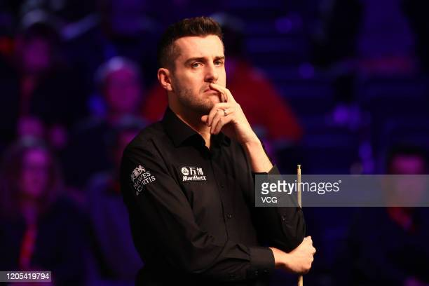 Mark Selby of England reacts during the 1st round match against David Grace of England on day one of the 2020 ManBetX Welsh Open at the Motorpoint...