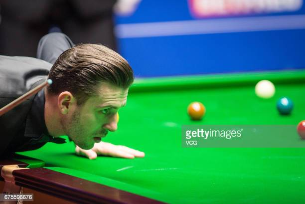 Mark Selby of England reacts during the final match against John Higgins of Scotland on day seventeen of Betfred World Championship 2017 at Crucible...
