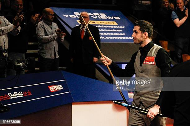 Mark Selby of England reacts in the semifinal against Marco Fu of Chinese Hong Kong on day fifteen of Betfred World Championship 2016 at The Crucible...