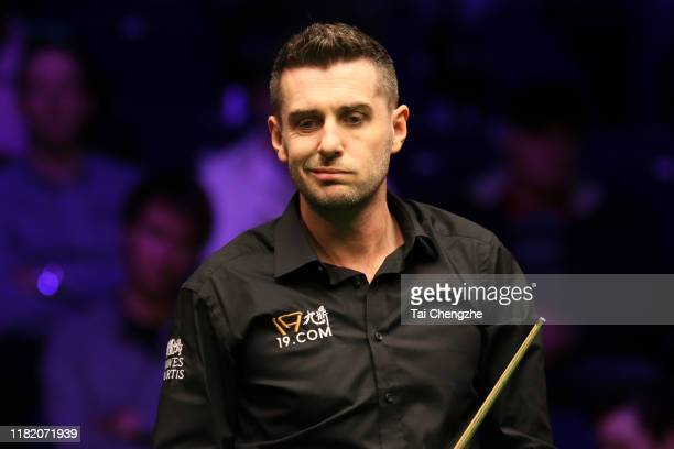 Mark Selby of England reacts in the semifinal match against Mark Allen of Northern Ireland on day six of 2019 English Open at K2 Leisure Centre on...