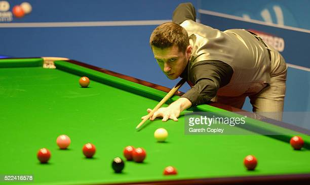Mark Selby plays a shot against Robert Milkins during their first round match of the World Snooker Championship at Crucible Theatre on April 19 2016...