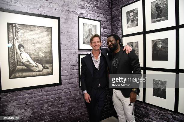 Mark Seliger and Marlon James pose during a private viewing of Mark Seliger 'Photographs' at Chase Contemporary on May 16 2018 in New York City