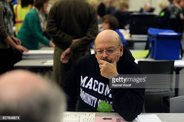 Mark Semet watches as volunteers and city officials participate in a recount at the Oakland Schools Conference Center on December 5 2016 in Waterford...